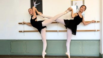 two ballet girls in arabesque on pointes